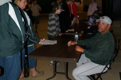 TinCaps Manager Jose Flores signs autographs