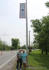 Chuck and Heidy Kiess under the newly installed banner