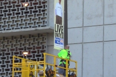 City crews hang banners